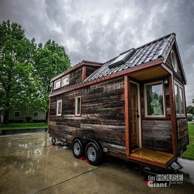 During dramatic stormy weather, Salies' house looks lovely. On a more practical note, it appears well-built and sealed up from the rain. (Tiny House Giant Journey)