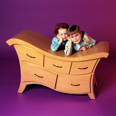 "Whitney Lou is a curvy dresser that's not just for kids. Measures 48""w x 20""h x 24""d. (Straight Line Designs)"