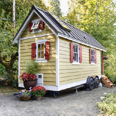 B = This yellow cottage on wheels hosts happy visitors, through airbnb. (Bayside Bungalow)