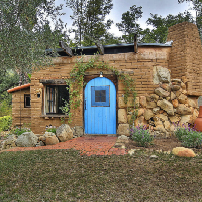 A = A former writer's retreat, built in the 1940s, has avoided several local forest fires. (Blue Door)