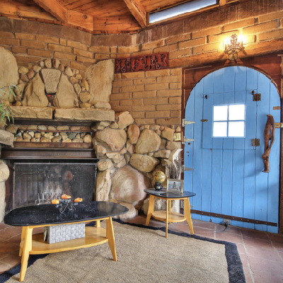 5 - An older tiny house uses a massive stone fireplace.