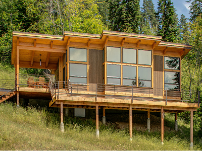 This TimberCab 550 kit home is located on Idaho's Lake Pend Oreille. The owners added an extra deck and porch to expand outdoor living on the hillside. (Fine Homebuilding)