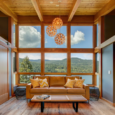 What a shining example of a great room, overseeing the lake! We love the lighting and furniture, though might arrange more seating in our own place. (Fine Homebuilding)