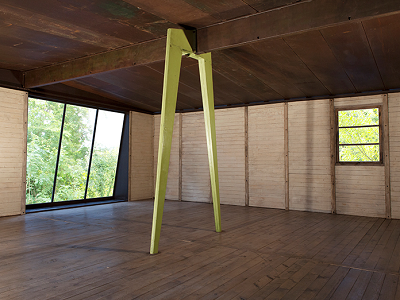 """Welcome to the empty interior of the Prouve shelter. Bent steel is used for the load-bearing, axial portal frame system. The architect developed and patented this """"demountable"""" approach in 1938. (Patrick Seguin)"""