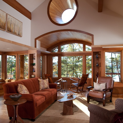 North Carolina Interior - See the spacious and main gathering area, which remains wide open to nature. There's no need to over emphasize decor when trees and lake views become focal points for the entire space. (Fine Homebuilding)