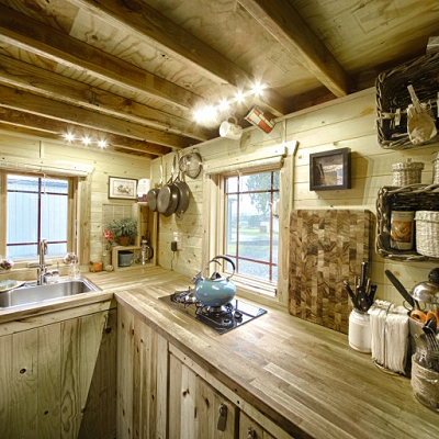 Tiny house owners Christopher and Malissa Tack surrounded all their windows with LED lighting. Their kitchen lights are shown here. (Tiny Tack House)