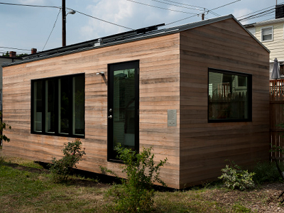 EXTERIOR, DC - The original Minim House, designed by owner Brian Levy and Foundry Architects, is located right in Washington, D.C. Minim sports dark, natural wood cladding as well as a black-trimmed front door and windows. (Minim Homes)