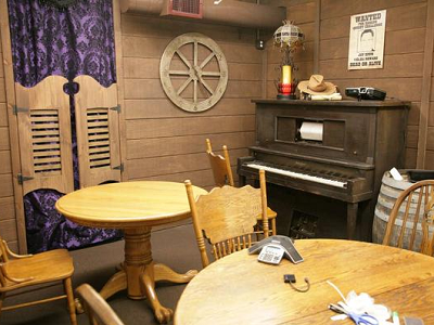 QUIXEY - In a saloon meeting room, featuring an 1880s piano, staffers transport to the Wild West. (SV Business Journal)