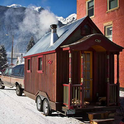 D - This tiny ski chalet has traveled to snowy destinations, racking up 20k miles. (Zack & Molly)