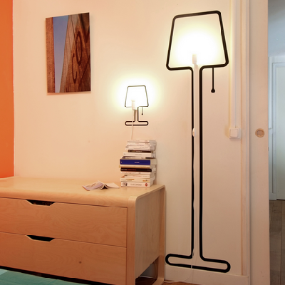 To operate these two lamps, place their stickers on the wall and affix cords and bulbs with a screw.(Pa-Design)