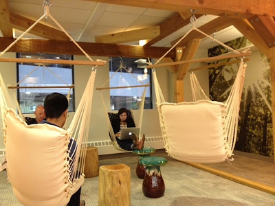 PAYPAL - Three Braintree employees are working comfortably in hammocks, rather than sitting at desks. (Braintree)