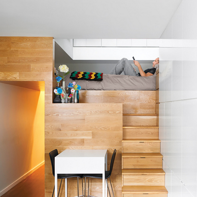 Using stairs as dresser drawers is a best practice, as seen in one straightforward and solid ascent to the sleeping area. This version is located in a Manhattan apartment. (Dwell)