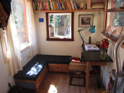 The custom made bench, storage, desk, chair and shelving make this tiny house special. (Oakland Tiny House)