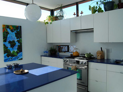 Michael and Aaron's kitchen is lovely, especially with the blue counters and white spaces. They live here! (Rocio Romero)
