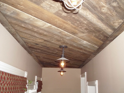 Brownback wood comes from the protected, unexposed back of reclaimed barn siding. Milled pieces get used to define the ceiling here. (JC Woodworking, Houzz)