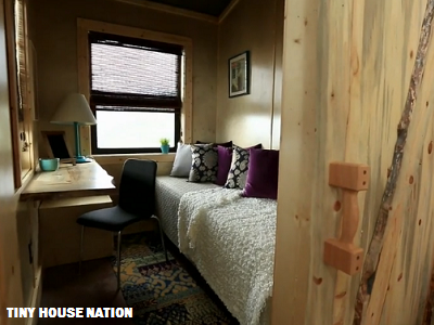 Next to David, Kristen writes books and consults from her own office with a desk, daybed and views. (Tiny House Nation)