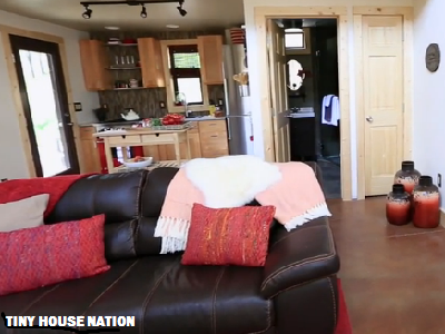 Here's the great room view into the Colorado home, with the bathroom to right and kitchen to left. (Tiny House Nation)