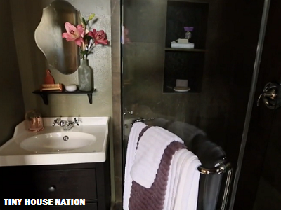 This Colorado home features a modern bathroom with a hip shower, sink and flush toilet. (Tiny House Nation)