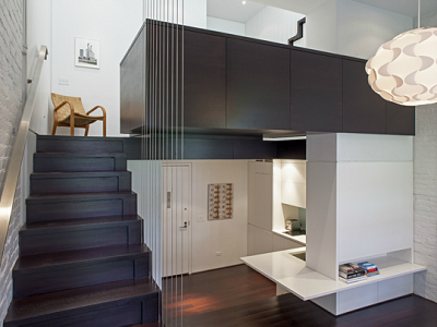 APARTMENT - This 425 sq. ft. space is 25 feet high. The kitchen, living room and bathroom are on the main floor, while the sleeping area gets cantilevered above. (Specht Harpman)