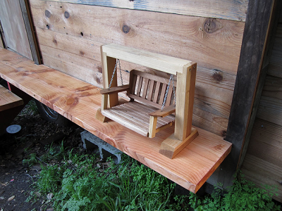 When a carpenter builds a tiny home, the porch swing becomes fine art. Look at the joinery! (Oakland Tiny House)