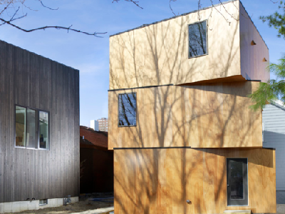 CAMBRIDGE, MA - This modern structure provides privacy yet surprisingly open and light interiors. Is it one or three units? (Archdaily)