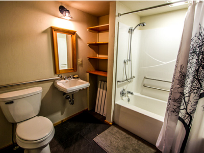 There's a full-sized bathroom in Blue Sky, likely appreciated by disabled and able-bodied users alike. (hobbitatspaces.com)