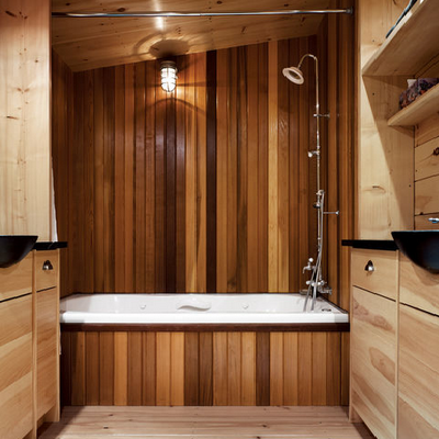 From the coast of Maine, this all-wood bathroom is an inviting indoor retreat. We like the storage as well different wood shades selected here. (Christopher Campbell, architect)